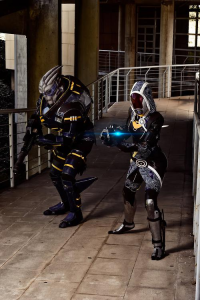 Adrian Winters as Garrus Vakarian, Laura Sánchez as Tali'Zorah nar Rayya