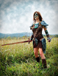April Gloria as Aela the Huntress